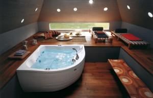 Приятный интерьер ванной комнаты, в которую идеально вписывается джакузи