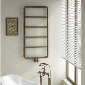 Фото бронзового полотенцесушителя в дизайне ванной комнаты