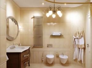 Интерьер ванной комнаты с бронзовым полотенцесушителем