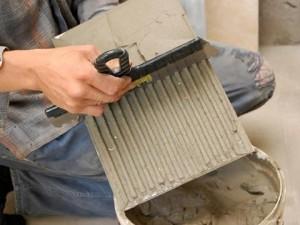 Процедура облицовки стен керамической плиткой