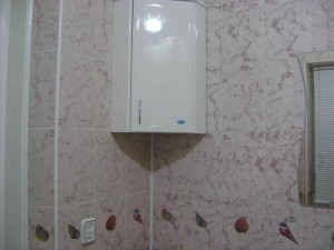 Фото углового шкафа в ванной комнате